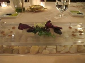 Amuse bouche, on a glass box of stones ...