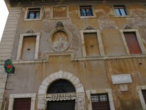 Pharmacy and shrine at Piazza San Bartolomeo All'Isola