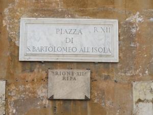 Sign at the tiny Piazza di San Bartolomeo All'Isola